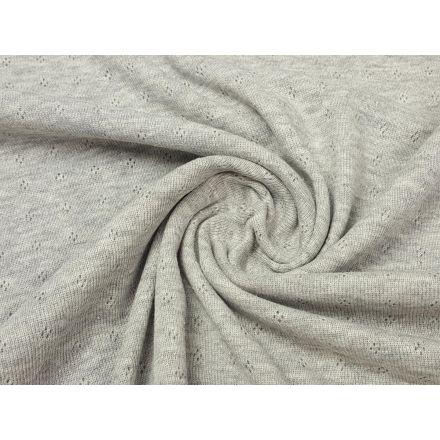 Schöner Baumwolljersey mit Lochstickerei  Material: 70% Baumwolle, 30% Polyethylen Breite: 135cm Gewicht: 155g/m²